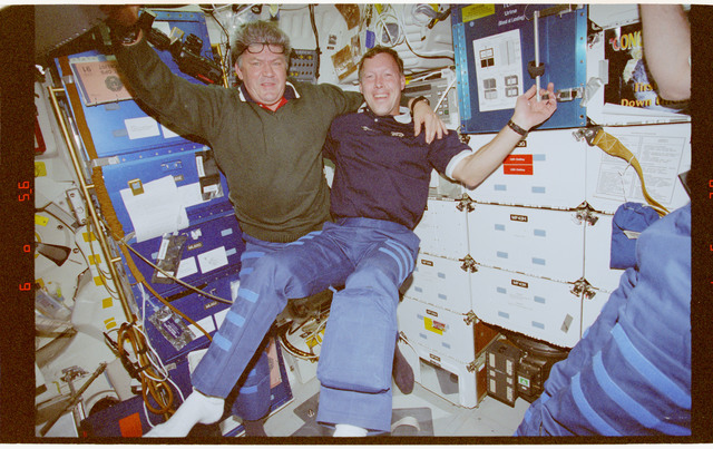 STS091-384-012 - STS-091 - Crewmember activity in the middeck and Spacehab