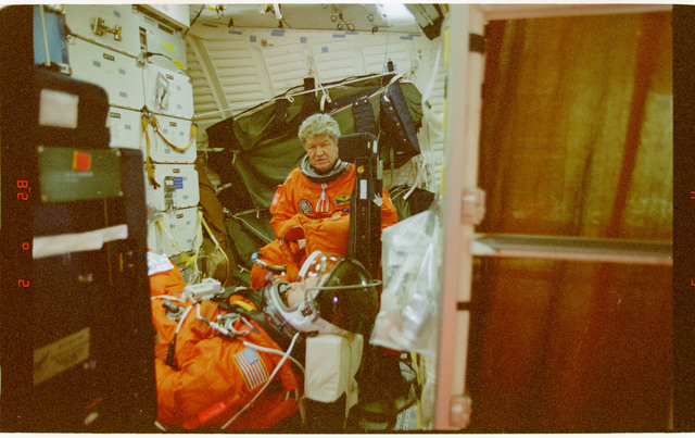 STS091-394-023 - STS-091 - Post landing view of launch entry suited crewmembers at ease in the middeck