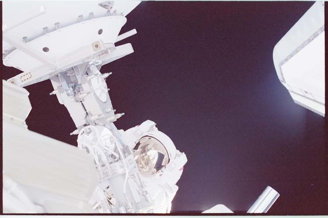 STS092-334-001 - STS-092 - Chiao during EVA next to SGANT boom