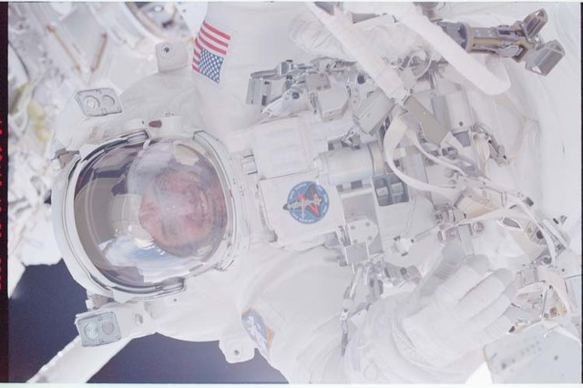 STS092-336-017 - STS-092 - Lopez-Alegria during EVA and reflection of Wisoff in his helmet
