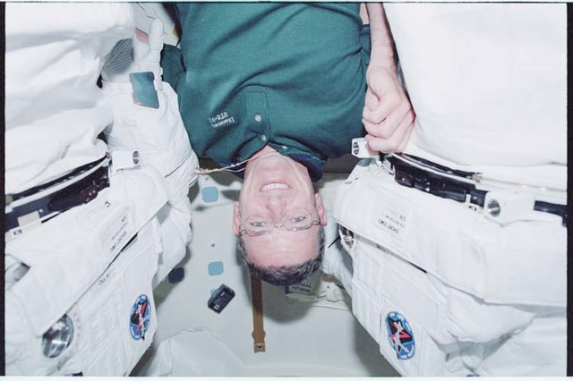 STS092-339-035 - STS-092 - McArthur in the airlock