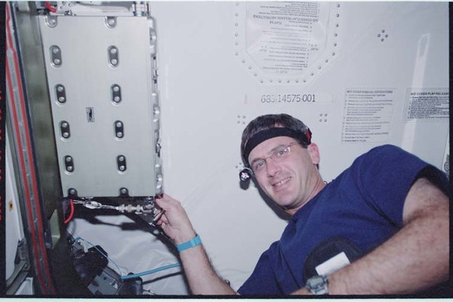 STS092-366-012 - STS-092 - Crewmembers work on Node 1 zenith CBM closeout