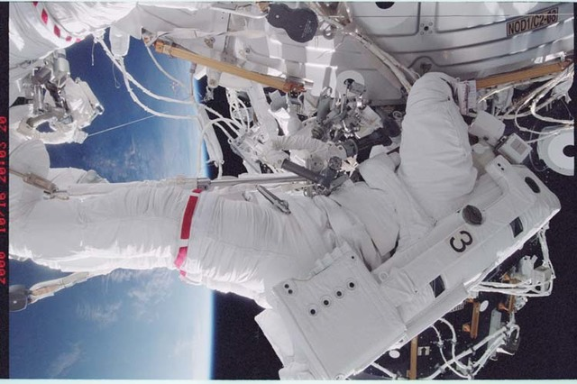 STS092-368-027 - STS-092 - Wisoff working on Node 1