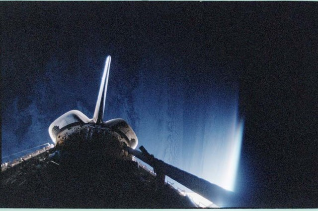 STS092-411-009 - STS-092 - Dark view of orbiter payload bay and RCS jet firing