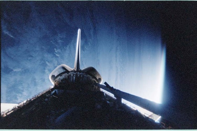STS092-411-011 - STS-092 - Dark view of orbiter payload bay and RCS jet firing