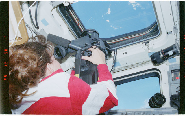 STS093-328-001 - STS-093 - STS-93 MS Coleman takes video footage from the flight deck of Columbia