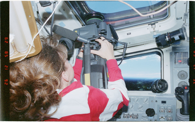 STS093-328-002 - STS-093 - STS-93 MS Coleman takes video footage from the flight deck of Columbia