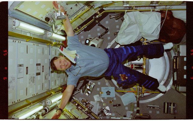 STS094-353-027 - STS-094 - Crouch flys through the Spacelab module
