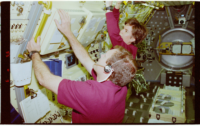 STS094-388-009 - STS-094 - Voss and Halsell in the Spacelab module