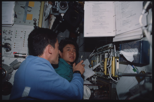 STS095-314-008 - STS-095 - ASC-8 - Mukai and Duque in Spacehab