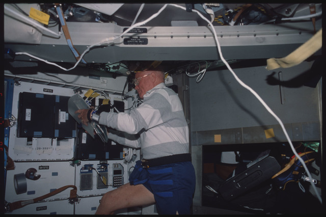 STS095-338-011 - STS-095 - NIH-C8 - Glenn on middeck