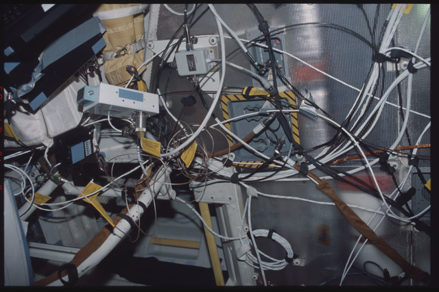 STS095-360-006 - STS-095 - Cables for various lockers on the middeck