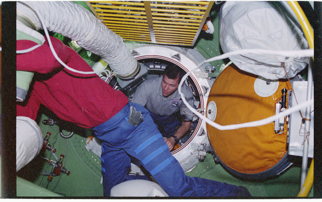 STS096-301-025 - STS-096 - MS Barry installs sound dampers over ventilation ducts in FGB/Zarya