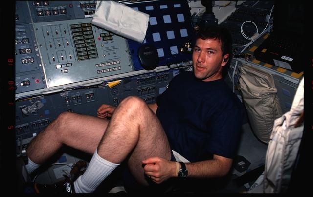 STS096-336-018 - STS-096 - PLT Husband exercises on ergometer on aft flight deck