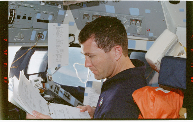 STS096-354-030 - STS-096 - PLT Husband at his station on the forward flight deck