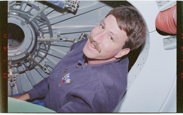 STS096-360-007 - STS-096 - CDR Rominger beside one of the CBM hatches on the Node 1/Unity module