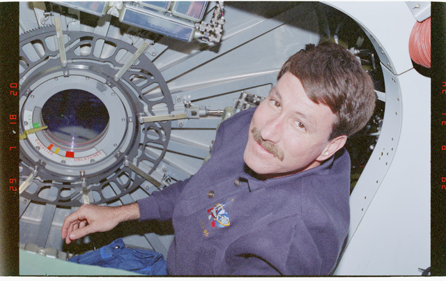 STS096-360-008 - STS-096 - CDR Rominger beside one of the CBM hatches on the Node 1/Unity module