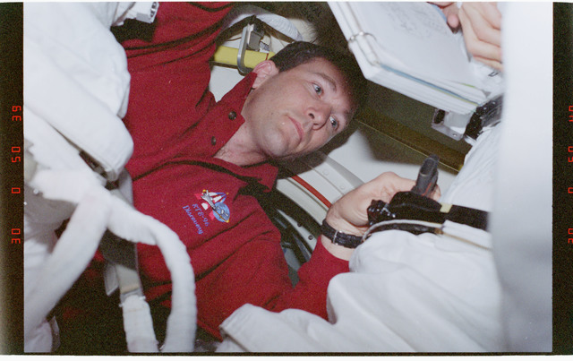 STS096-360-022 - STS-096 - PLT Husband (IVA team) in airlock