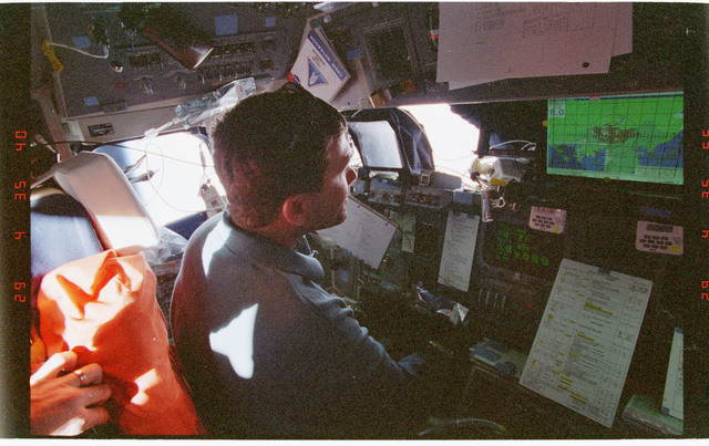 STS096-361-032 - STS-096 - PLT Husband  at forward flight deck during docking