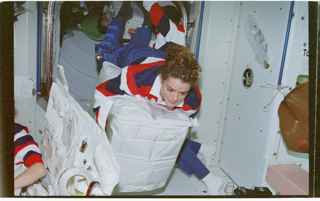 STS096-366-036 - STS-096 - MS Payette flys through Node 1/Unity with stowage bag