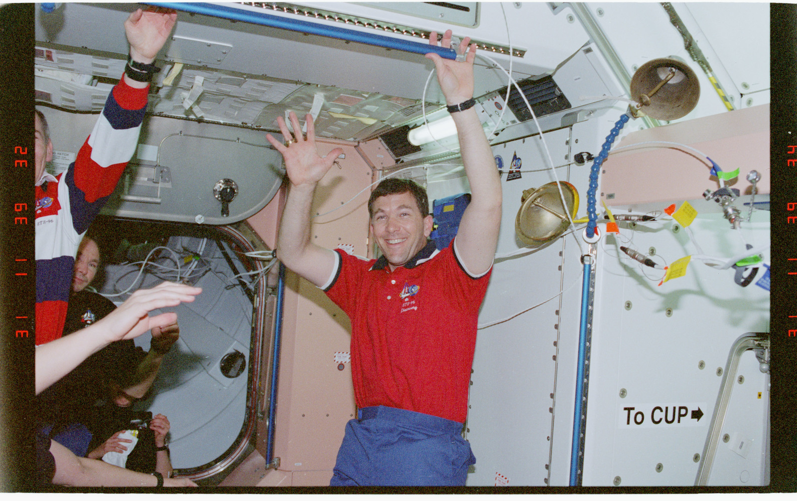 STS096-368-026 - STS-096 - View of the STS-96 crew in the Node 1/Unity module