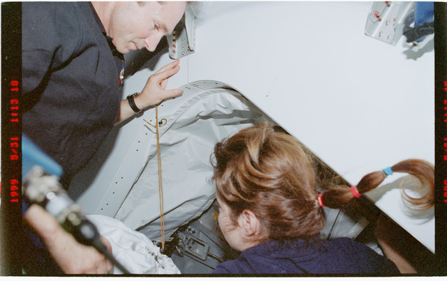 STS096-376-006 - STS-096 - MS Jernigan and MS Tokarev prepare to enter the ISS