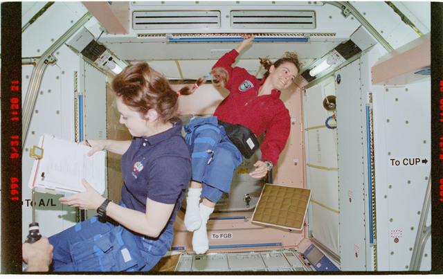 STS096-376-016 - STS-096 - MS Jernigan and MS Payette in the Node 1/Unity module