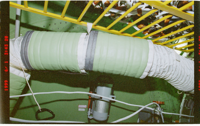 STS096-377-033 - STS-096 - Mufflers attached to ventilation hoses in the FGB/Zarya module