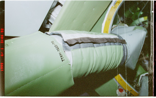 STS096-377-037 - STS-096 - Mufflers attached to ventilation hoses in the FGB/Zarya module