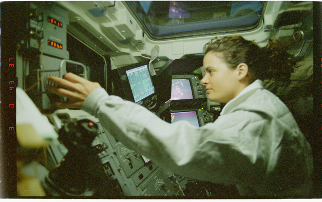 STS096-378-022 - STS-096 - MS Payette at RMS controls on aft flight deck