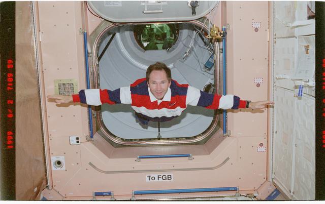 STS096-379-007 - STS-096 - MS Tokarev flys through Node 1/Unity