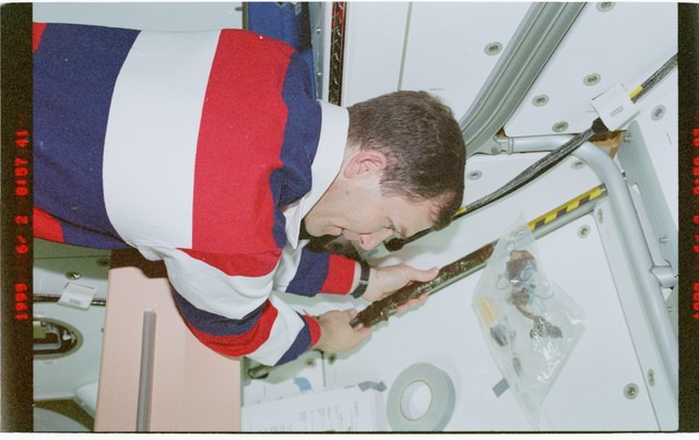 STS096-379-034 - STS-096 - PLT Husband on Node 1/Unity module