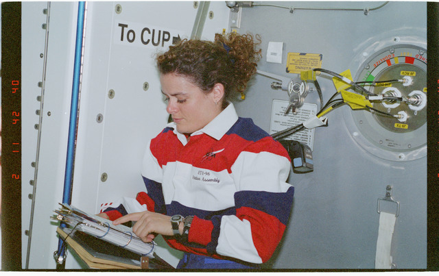 STS096-382-018 - STS-096 - MS Payette studies a checklist in the Node 1/Unity module