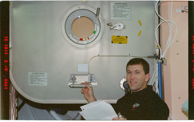 STS096-383-015 - STS-096 - PLT Husband performs IFM on Node 1/Unity aft hatch