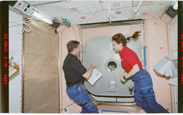 STS096-383-016 - STS-096 - PLT Husband and MS Jernigan perform IFM on Node 1/Unity aft hatch