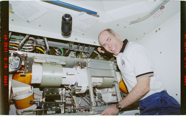 STS096-383-022 - STS-096 - MS Barry inspects ventilation hardware in Node 1/Unity module