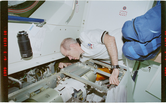 STS096-383-023 - STS-096 - MS Barry inspects ventilation hardware in Node 1/Unity module