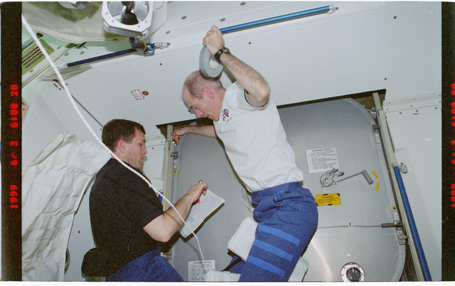 STS096-392-021 - STS-096 - PLT Husband and MS Barry works with hatch in Node 1/Unity module