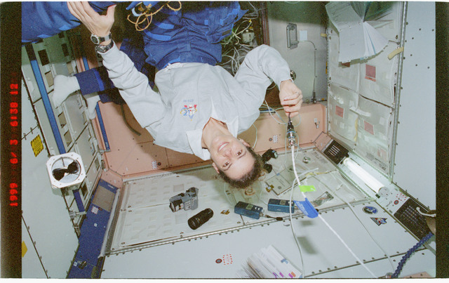 STS096-392-037 - STS-096 - Various views of the STS-96 crew tumbling in the Node 1/Unity module