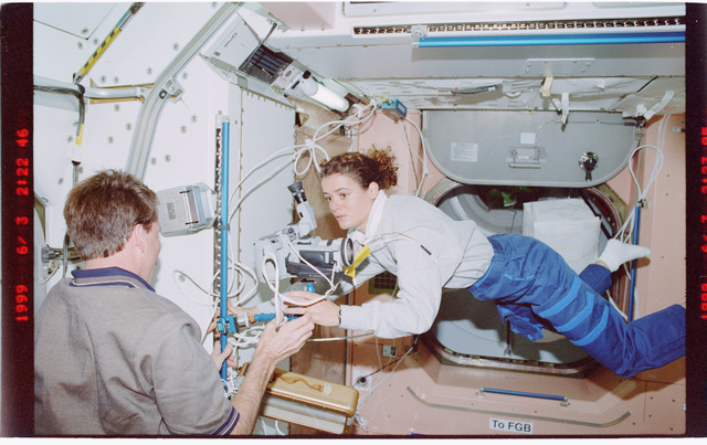STS096-407-011 - STS-096 - MS Payette installs camera on mount in the Node 1/Unity module