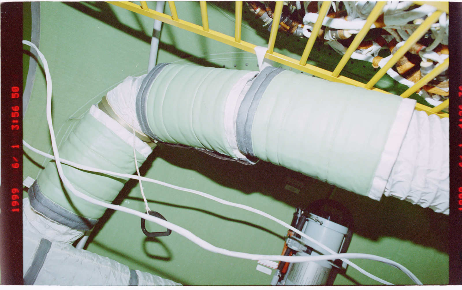 STS096-409-002 - STS-096 - Sound supressions equipment attached to ventilation hoses