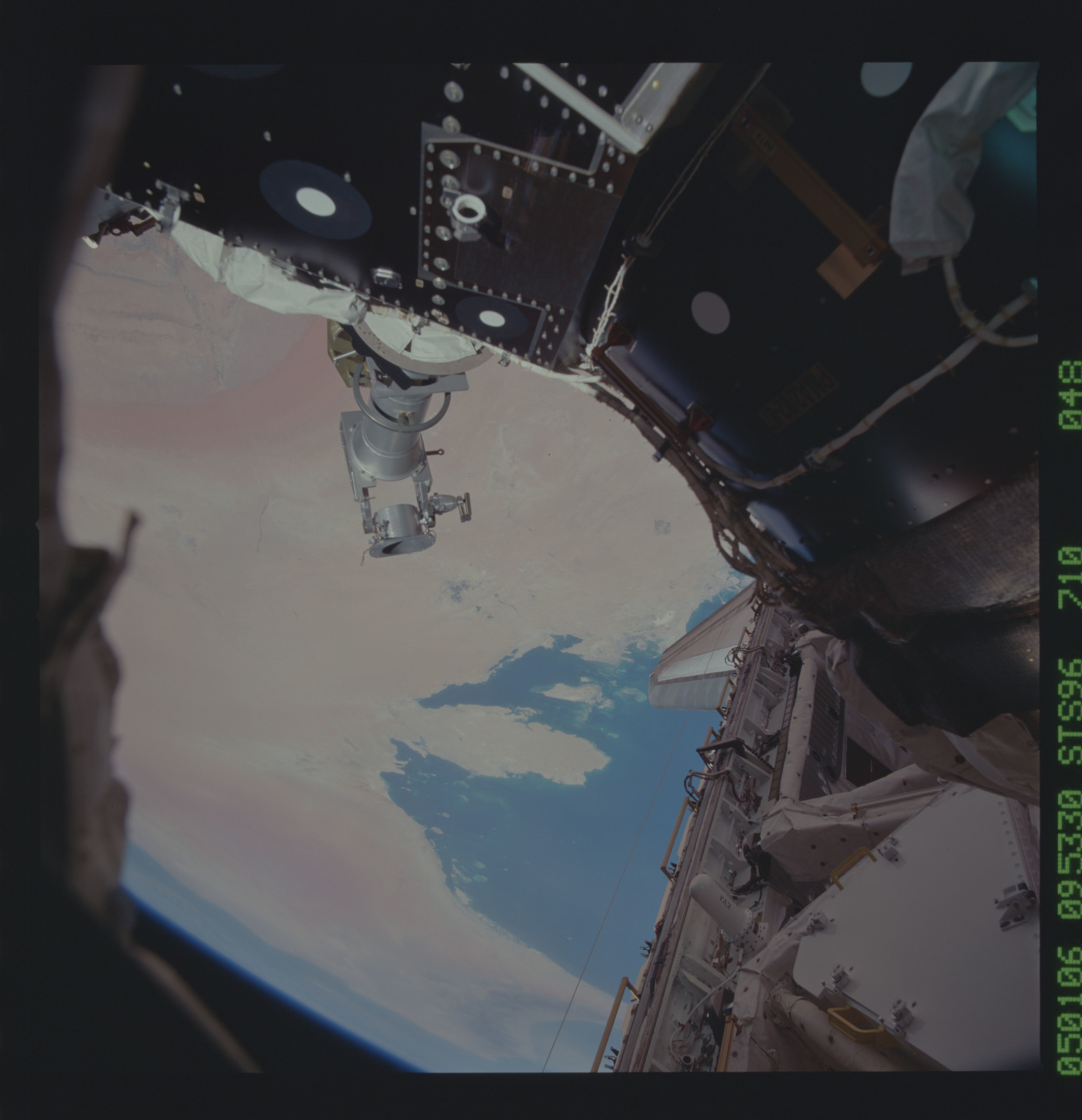 STS096-710-048 - STS-096 - View of the STS-96 EVA