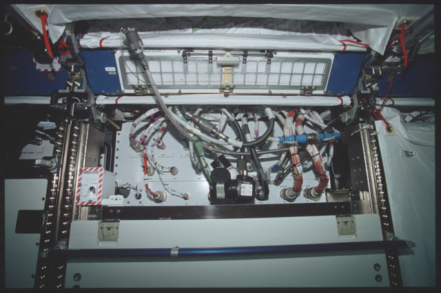 STS098-314-016 - STS-098 - Cables and wiring in one of the ... on transmission rack, conduit rack, controller rack, switch rack, cable rack, dart rack, power rack, painting rack, audio rack, wood rack, hollywood rack, harness rack, electrical rack,