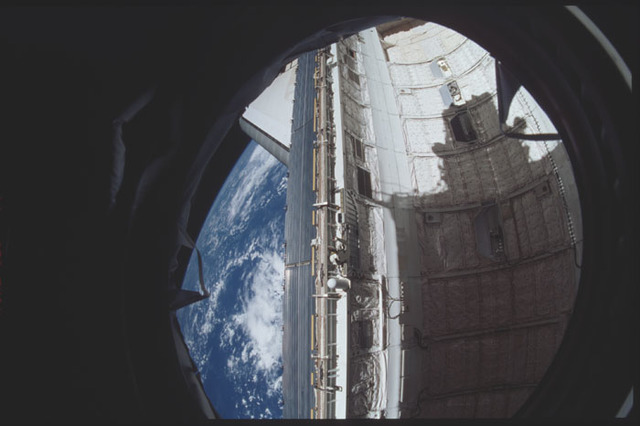 STS098-314-025 - STS-098 - View of Atlantis payload bay from U.S. Lab window