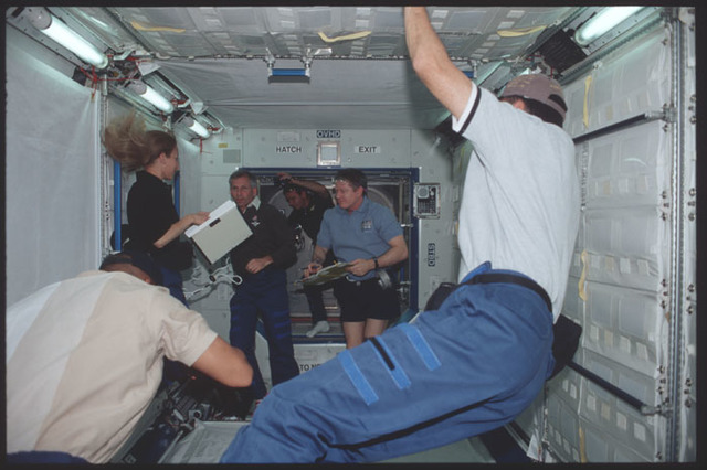STS098-323-008 - STS-098 - Expedition One and STS-98 crew in U.S. Laboratory