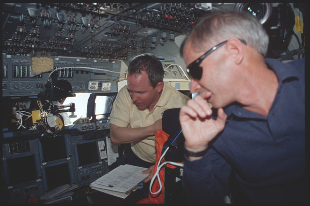 STS098-326-016 - STS-098 - Jones and Cockrell on forward flight deck