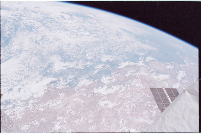 STS098-335-010 - STS-098 - Earth observation view with portion of RMS