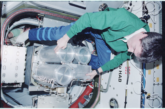 STS098-346-030 - STS-098 - Krikalev at work in Node 1 hatch area