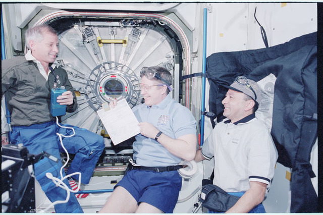 STS098-352-019 - STS-098 - STS-98 and Expedition One crew prepare to open U.S. Lab hatch