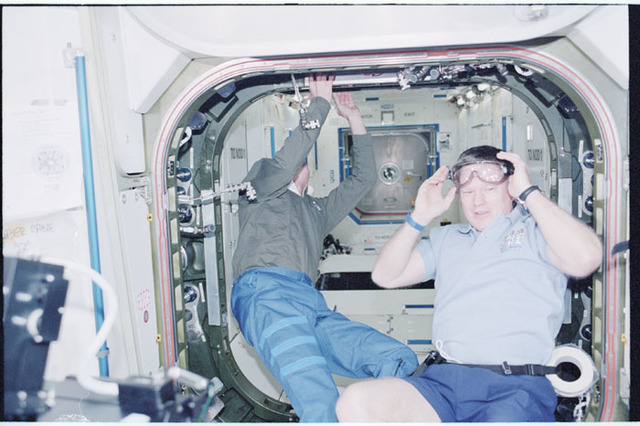 STS098-352-026 - STS-098 - STS-98 and Expedition One crew prepare to open U.S. Lab hatch